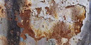 silver metal with heavy orange rusting